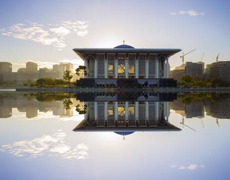 prayer tower: Sunrise view at Masjid Besi (Iron Mosque) or Masjid Tuanku Mizan Zainal Abidin, Putrajaya, Malaysia with reflection Editorial
