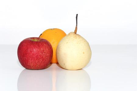 transgenic: Apples and orange fruit Stock Photo