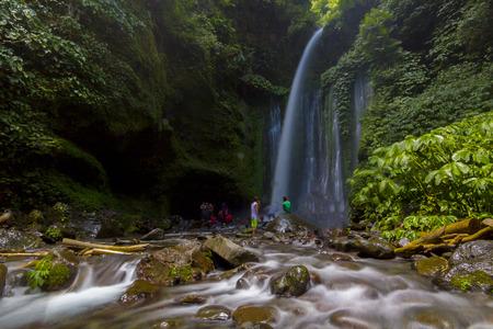 LOMBOK, INDONESIA: Tiu Kelep waterfall in Senaru, Lombok, Indonesia. Too many tourists from abroad.