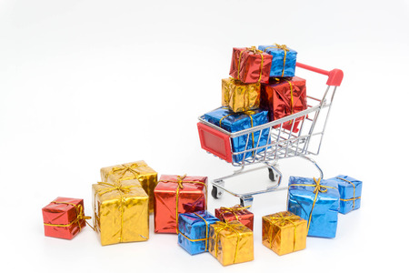 set colorful gift boxes with trolley on white background