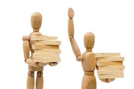 Business concepts, robots carry wooden blocks. Stock Photo