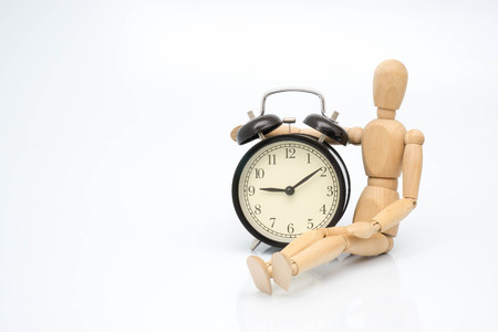 Concept clock bell with wooden robot
