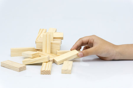 Hand of kid playing a blocks wood