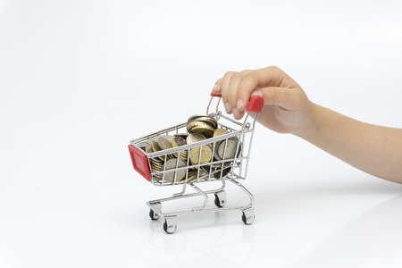 The hand of the child holds a coin trolley