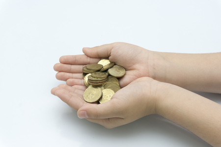 the hand of the child holds the coin