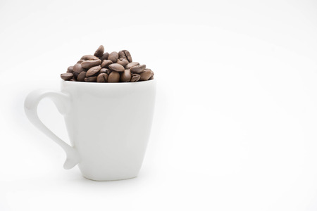 coffee beans and white cups with white background