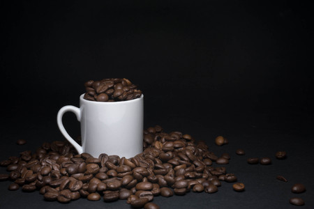 coffee beans and cups with low light Stock Photo