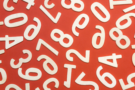 wooden numbers on red paper
