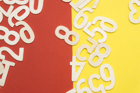 The numbers are cluttered on red and yellow paper