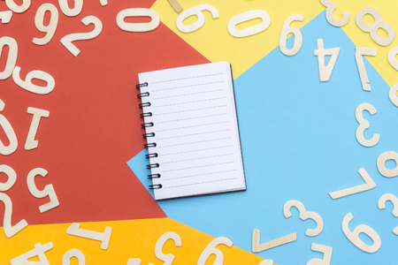 note book and scattered numbers on colorful paper