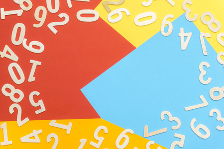 scattered numbers on colorful paper