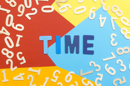 words TIME amid colorful paper and scattered numbers Stock Photo