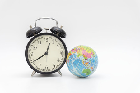Earth and clock, the concept of world time now Stock Photo