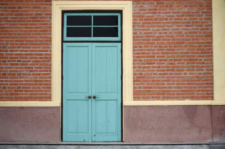 louver: Light blue combination door with subframe and brick wall Stock Photo