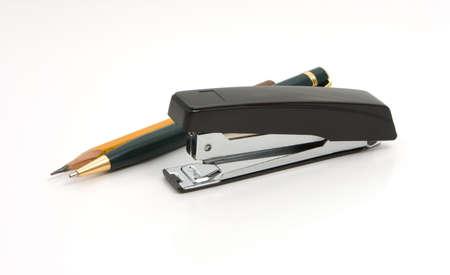 Black stapler and pen`s Stock Photo