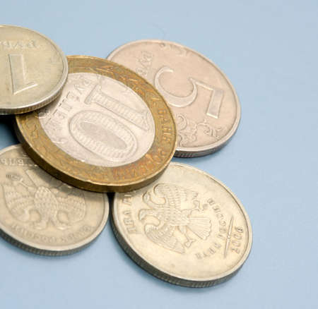Coins on colored (blue) background. Close-up. Coins of Russian Federation bank