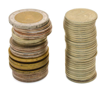 Two heap of coins on a white background. Isolated Stock Photo