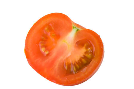 The cut tomato on a white background