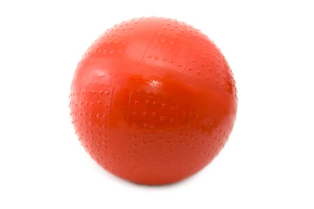 Red childrens rubber ball on a white background