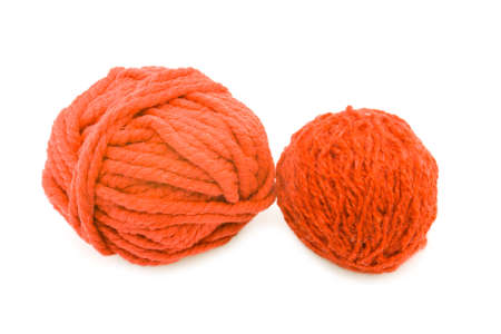two red threads for knitting on a white background photo