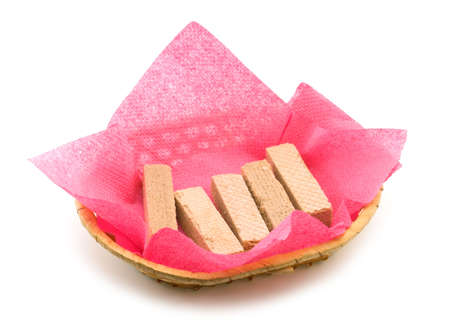 Wafers in a wattled basket on a red napkin   Stock Photo