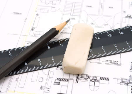 Ruler, eraser and a pencil on the floor plan - Bussines a still-life photo