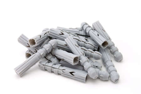 Heap of a plastic dowels on a white background Stock Photo