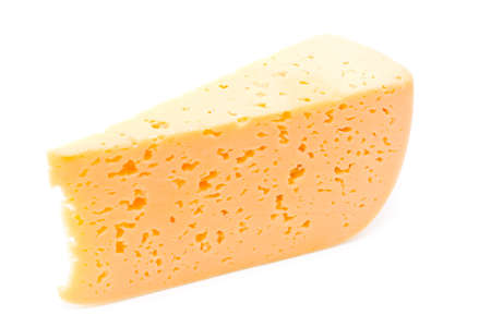 Slice of firm cheese on a white background