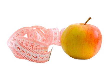 The untwisted measuring tape and apple on a white background