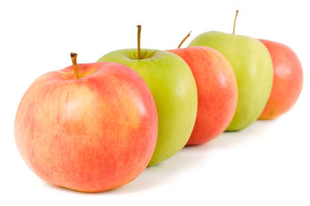 Five apples - green and red - on a white background