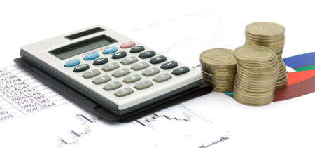 Single calculator and heap of coins on a stock-diagram. Business stil-life Stock Photo