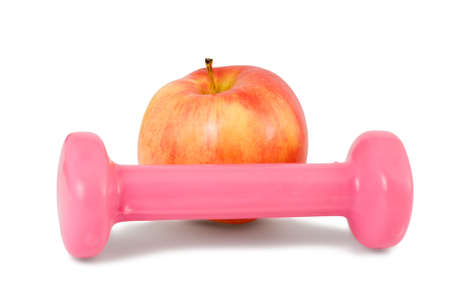 one dumbbell and red apple on a white background