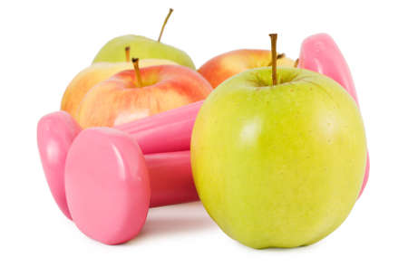 two dumbbells and some apples on a white background. Concept of fitness and healthy lifestyle