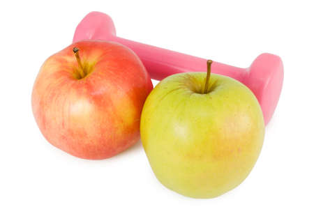 pink dumbbells and two apples on a white background Stock Photo