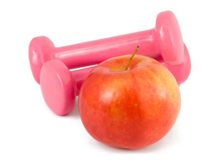 two dumbbells and red apple on a white background
