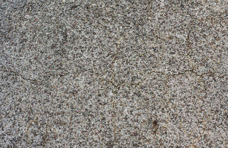 Surface covered with small stones - a picture for a texture or a background. Natural light in a sunny day