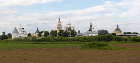 Spaso-Prilutsky monastery (the city of Vologda, Russia) in beams of the evening sun. The view from the opposite bank of the river