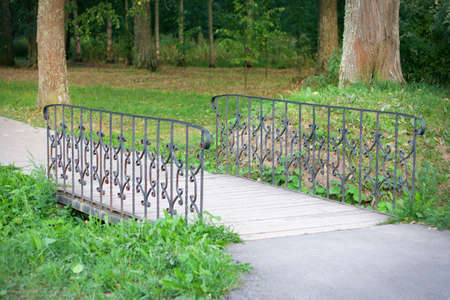 The foot bridge with the iron forged handrail Stock Photo