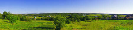 Rural panoramic view with trees and river Stock Photo