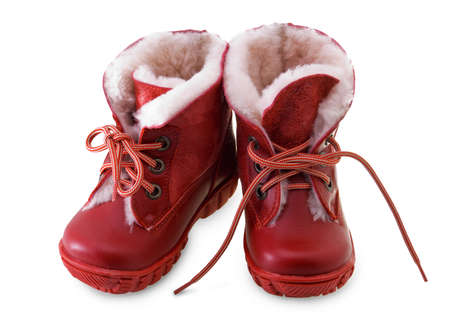 two red childrens boots on a white background