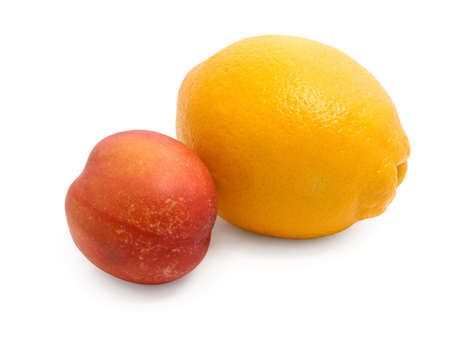 Citrus (lemon) and peach on a white background