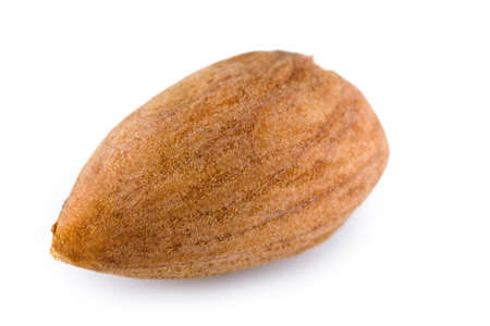 Single almond nut on a white background