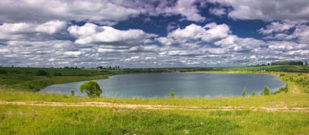 panorama of the artificial lake in the sunny summer day