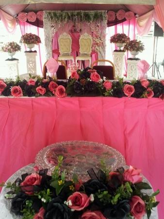 realtionship: pink cheerful decoration malay wedding reception Stock Photo