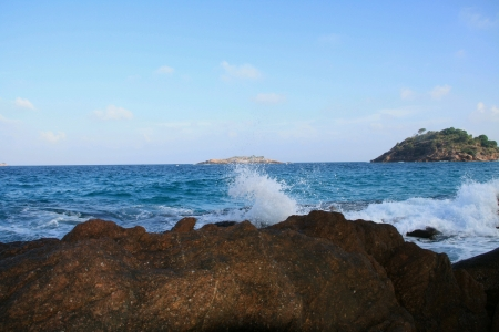 wave hit the rock at redang island malaysia