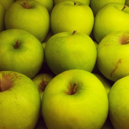 fresh green apples nicely stack