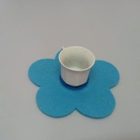 White cup on top of flower shape cover