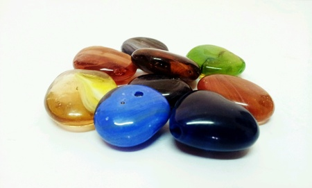 Colorful carving marbles close up isolated Stock Photo
