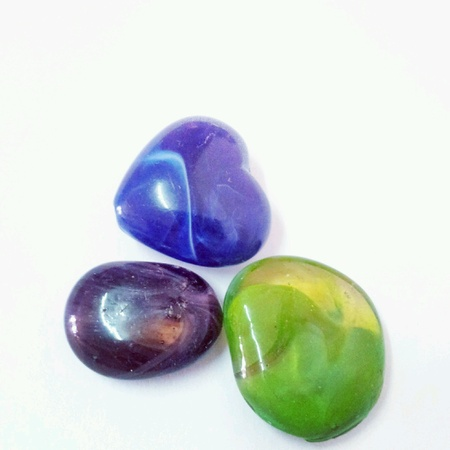 Colorful carving stone marbles close up isolated Stock Photo
