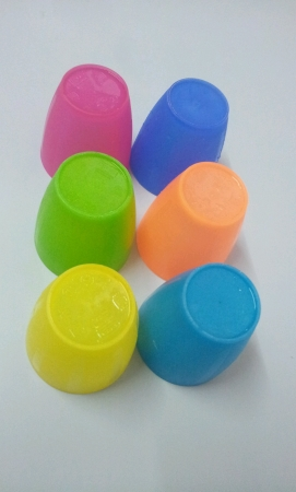 Six colourful plastic cup isolated Stock Photo